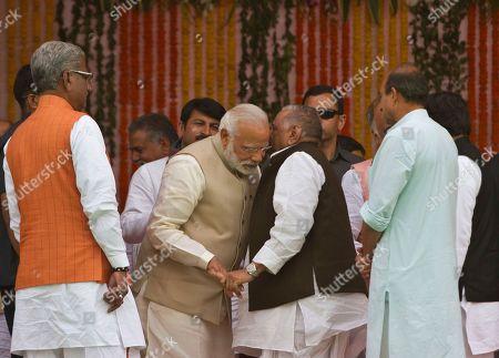 Narendra Modi, Mulayam Singh Yadav Indian Prime Minister Narendra Modi, center left, listens to Samajwadi party leader Mulayam Singh Yadav during the swearing in of Yogi Adityanath as Uttar Pradesh state chief minister in Lucknow, India