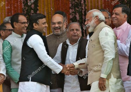 Indian Prime Minister Narendra Modi, second right, shares a lighter moment with former Uttar Pradesh chief minister Akhilesh Yadav, third left as Samajwadi party leader Mulayam Singh Yadav, center and others react during the swearing in of Yogi Adityanath as Uttar Pradesh state chief minister in Lucknow, India