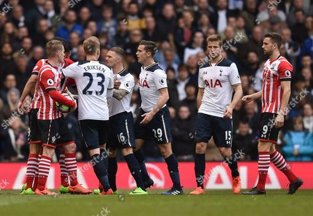 Kieran Trippier and Shayon Harrison of Tottenham Hotspur are held back by Christian Eriksen from Sofiane Boufal of Southampton during the Premier League match between Tottenham Hotspur and Southampton played at White Hart Lane, London on 19th March 2017