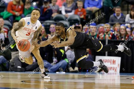 Kyle Davis, Rashard Kelly Wichita State forward Rashard Kelly (0) dives to stop the steal of Dayton guard Kyle Davis (3) during the first half of a first-round game in the men's NCAA college basketball tournament in Indianapolis