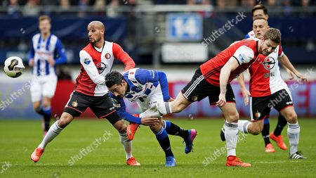 Karim El Ahmadi (L) and Jan-Arie van der Heijden (R) of Feyenoord Rotterdam with Reza Ghoochannejhad  of Heerenveen during the Dutch Eredivisie soccer match between Feyenoord Rotterdam and SC Heerenveen in Heerenveen, The Netherlands, 19 March 2017.