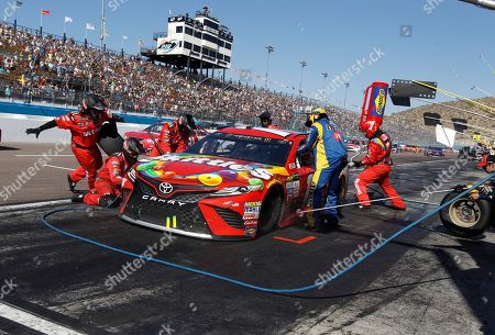 Race leader Kyle Busch makes a pit stop during a caution flag during the NASCAR Cup Series auto race at Phoenix International Raceway, in Avondale, Ariz. During the stop Ryan Newman elected not to pit and went on to win the race