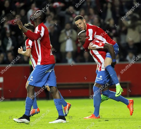 Sporting Gijon´s midfielder Lacina Traore (L) from Ivory Coast celebrfates after scoring against Granada CF during their Spanish First Division soccer match played at El Molinon stadium in Gijon, 19 March 2017.