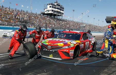 Race leader Kyle Busch makes a pit stop during a caution period in the NASCAR Cup Series auto race at Phoenix International Raceway, in Avondale, Ariz. Ryan Newman stayed out on the track and went on to win the race
