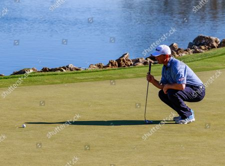 Orlando, Florida, USA-Greg Chalmers gets ready to putt on the 18th hole during the final round of the Arnold Palmer Invitational