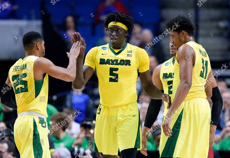 Johnathan Motley, Al Freeman, Terry Maston Baylor' Al Freeman (25), Johnathan Motley (5) and Terry Maston (31) celebrate a basket by Motley in the first half of a second-round game against Southern California in the men's NCAA college basketball tournament in Tulsa, Okla