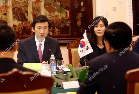 South Korean Foreign Minister Yun Byung-se, left, speaks with his Vietnamese counterpart Pham Binh Minh during talks in Hanoi, Vietnam, . Yun is on a two-day visit to the Southeast Asian nation boost ties between the two countries