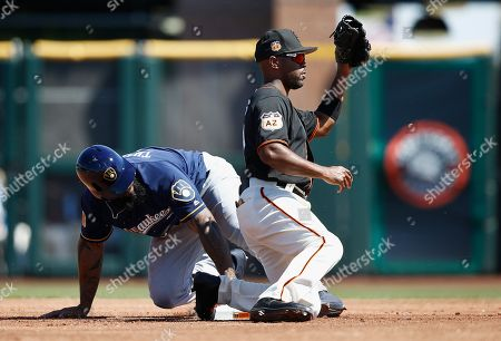 Stock Image of San Francisco Giants shortstop Jimmy Rollins, right, takes a late throw as Milwaukee Brewers' Eric Thames, left, steals second base during the first inning of a spring training baseball game, in Scottsdale, Ariz