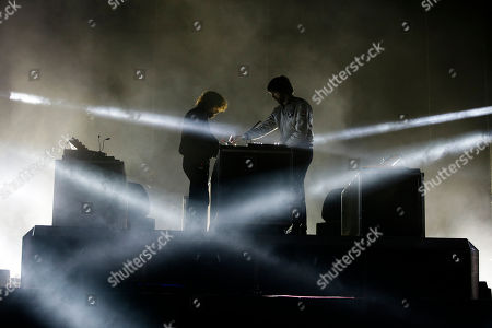 Gaspard Auge, left, and Xavier de Rosnay of the French electronic music duo Justice perform at Vive Latino in Mexico City, just after midnight on . The Vive Latino Festival has become Latin America's biggest Latin rock celebration