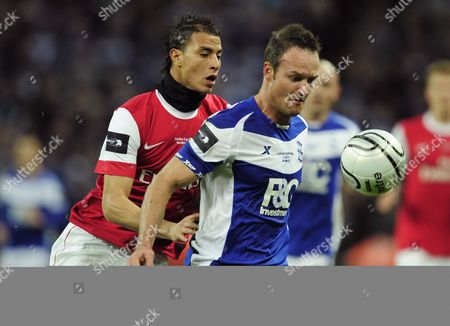 Marouane Chamakh of Arsenal and Martin Jiranek of Birmingham City United Kingdom London