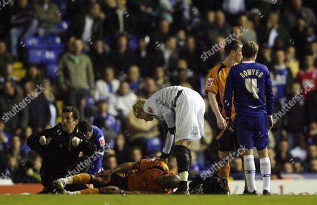 Chris Iwelumo of Wolverhampton Wanderers Lies Injured On the Pitch United Kingdom Birmingham