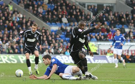 Ipswich Town Striker Jason Scotland Has A Shot at Goal Under Pressure From Cardiff City Defender Mark Hudson United Kingdom Cardiff