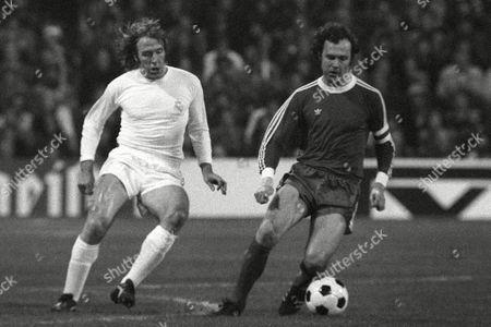 Real Madrid's Gunter Netzer (l) Closes Down Bayern Munich's Franz Beckenbauer (r) File Photo Dated 14/4/1976