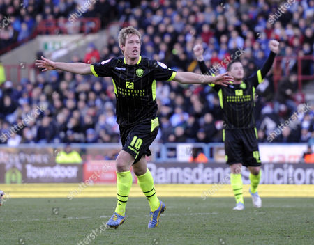 Luciano Becchio of Leeds Celebrates After Scoring Their Fourth Goal As Ross Mccormack Joins the Celebrations in the Background United Kingdom Huddersfield