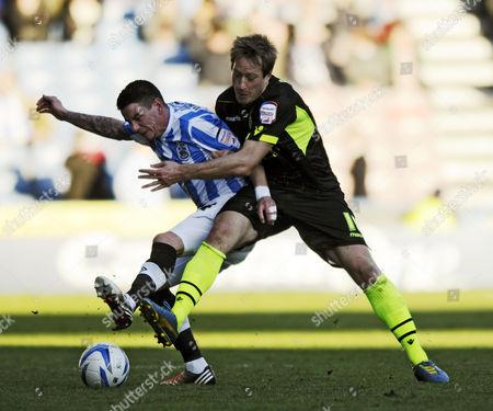 Adam Hammill of Huddersfield (l) Holds Off Luciano Becchio of Leeds United Kingdom Huddersfield