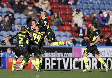 Leeds Pile in to Celebrate with Goalscorer Luciano Becchio (c) United Kingdom Huddersfield