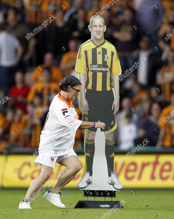 A Hull City Fan Runs Around A Cardboard Cut out of Dean Windass During the Half Time Entertainment