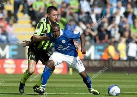 Darius Vassell of Leicester City and Marcos Painter of Brighton and Hove Albion United Kingdom Leicester
