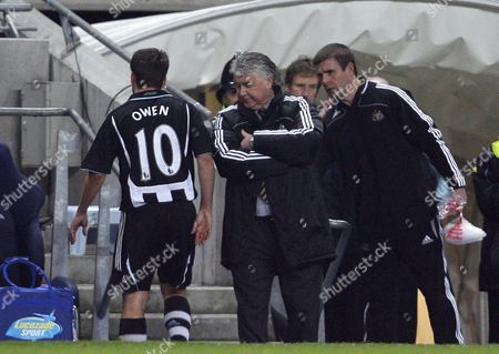 A Dejected Newcastle United Manager Joe Kinnear Looks Towards Michael Owen Who Leaves the Game Through Injury United Kingdom Manchester