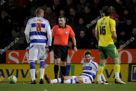 Referee J Moss Walks Past Adel Taarabt of Qpr Who Sits On the Ground After Being Fouled United Kingdom Norwich