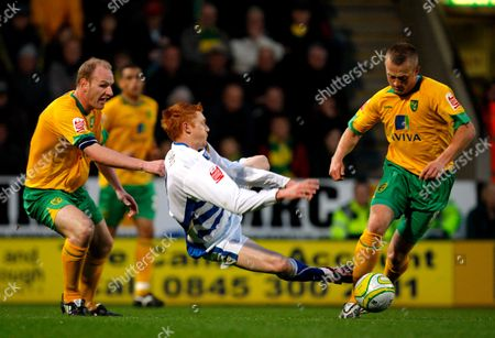 Dave Kitson of Reading is Brought Down by Gary Doherty and Sammy Clingan of Norwich City United Kingdom Norwich