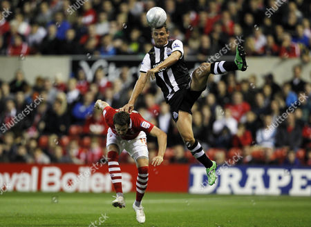 Stock Image of Peter Lovenkrands of Newcastle United and Chris Gunter of Nottingham Forest United Kingdom Nottingham