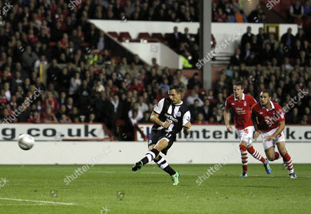 Peter Lovenkrands of Newcastle United Scores His Goal to Make It 1-1 From the Penalty Spot United Kingdom Nottingham