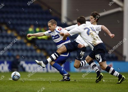 Heider Helguson of Qpr Takes On Adam Barton of Preston North End and Ian Ashbee United Kingdom Preston