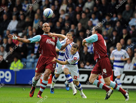 Jamie Mackie of Qpr Challenges For the Ball with Chris Iwelumo and Michael Duff of Burnley United Kingdom London