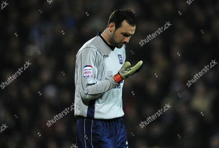 Ipswich Town Goalkeeper Marton Fulop Spits in His Glove United Kingdom London