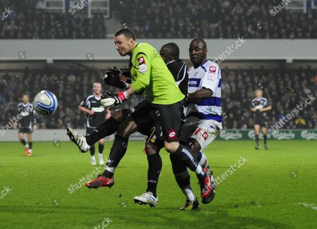 Jason Scotland of Ipswich Town is Beaten to the Ball by Qpr Goalkeeper Paddy Kenny and Ishmael Miller United Kingdom London