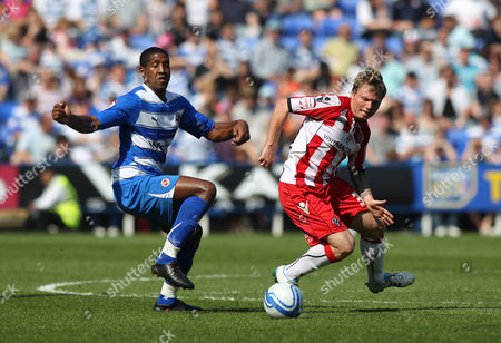Mikele Leigertwood of Reading in Action with Bjorn Helge Riise of Sheffield United United Kingdom Reading