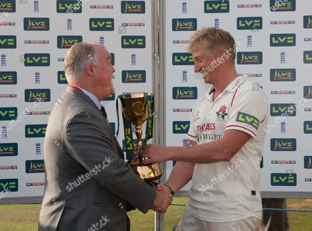 Glen Chapple of Lancashire is Presented with the Lv County Championship Trophy by Mike Gatting