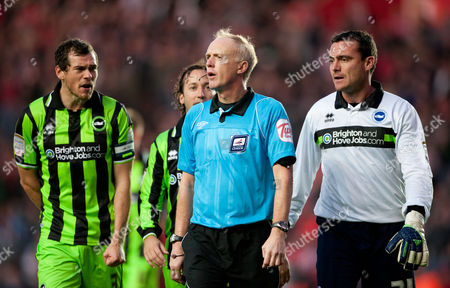 Stock Photo of Referee Peter Walton is Confronted by Goalkeeper Steve Harper Gordon Greer and Mauricio Tarrico of Brighton and Hove Albion United Kingdom Southampton