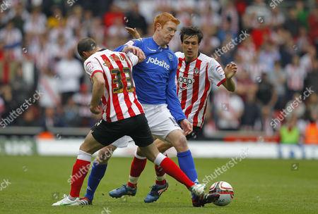 Dave Kitson of Portsmouth Battles with Steve De Ridder and Jose Fonte of Southampton United Kingdom Southampton