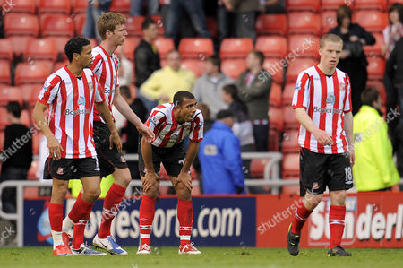 Dejected Sunderland Players Anton Ferdinand Calum Davenport Grant Leadbitter and Carlos Edwards at the End of the Game United Kingdom Sunderland