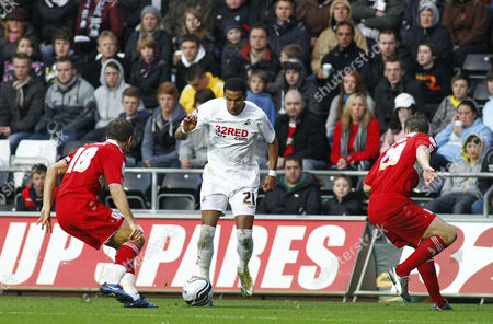 Stock Picture of Swansea City Striker Scott Sinclair Looks to Go Past Middlesbrough Midfielder Gary O'neil and Team Mate Anthony Mcmahon United Kingdom Swansea
