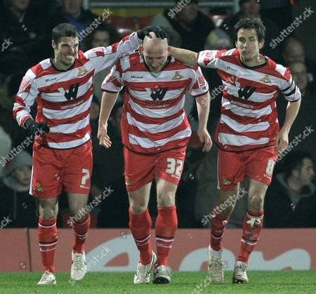 Stock Photo of Steve Brooker of Doncaster Rovers is Congratulated by Team Mates Lewis Guy and Brian Stock For His Equalising Goal United Kingdom London