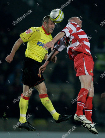 Jay Demerit of Watford and Steve Brooker of Doncaster Rovers United Kingdom London