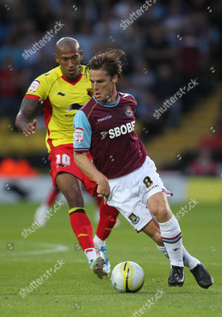 Scott Parker of West Ham United in Action with Chris Iwelumo of Watford United Kingdom London