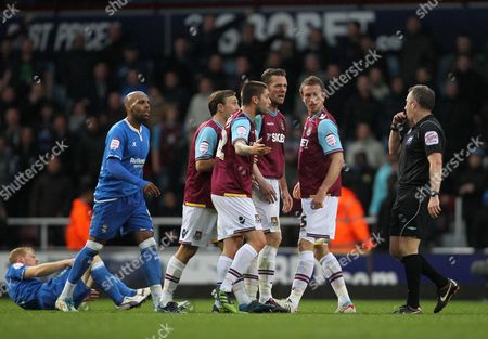 Referee John Moss Waves Away Protests From Kevin Nolan Henri Lansbury Mark Noble and George John of West Ham United As Marlon King of Birmingham City Looks On United Kingdom London