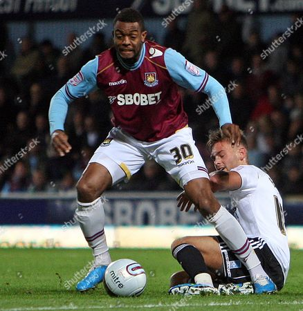 Frederic Piquionne of West Ham United and James Bailey of Derby County United Kingdom London