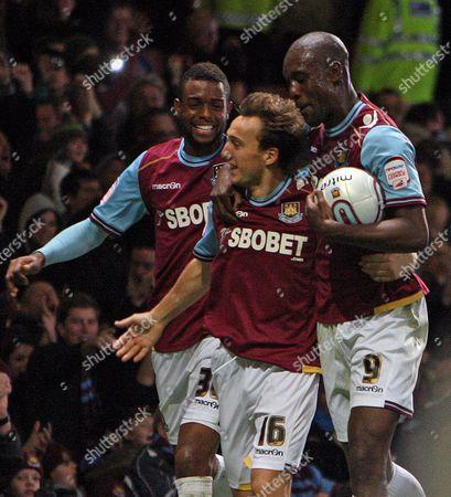 Mark Noble of West Ham United Celebrates Scoring A Goal to Make the Score 3-1 with Carlton Cole and Frederic Piquionne United Kingdom London