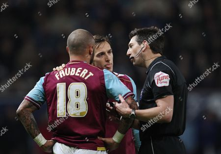Referee Lee Probert Has A Word with Julien Faubert As Mark Noble of West Ham United Looks On United Kingdom London