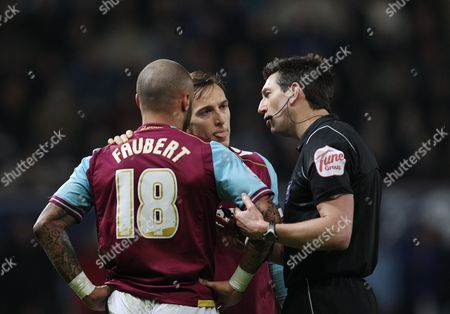 Referee Lee Probert Speaks with Julien Faubert and Mark Noble of West Ham United United Kingdom London