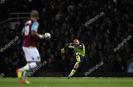 Kelvin Davis of Southampton Takes A Goal Kick As Julien Faubert of West Ham United Looks On United Kingdom London