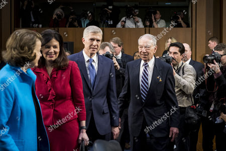 Neil Gorsuch (C) is escorted to his seat by Senator Dianne Feinstein (L), Former New Hampshire Senator Kelly Ayotte (2-L)  and Committe Chairman Chuck Grassley (R), as he arrives to appear before the Senate Judiciary Committee hearing on his nomination to be an associate justice of the Supreme Court, on Capitol Hill in Washington, DC, USA, 20 March 2017. Gorsuch, who was nominated by US President Donald J. Trump on 31 January 2017, begins his confirmation hearing 401 days after the death of Justice Antonin Scalia. Senate Republicans refused to vote or hold confirmation hearings on former President Barack Obama's nomination of Judge Merrick Garland, resulting in the longest opening on the court since the 1860s.