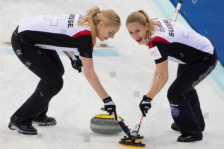 Switzerland's Nicole Schwagli, right and Nadine Lehmann, sweeps the stone against Canada for the CPT World Women's Curling Championship 2017 (WWCC) held in Beijing's Capital Gymnasium