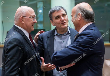 Michel Sapin, Euclid Tsakalotos and Luis De Guindos Jurado