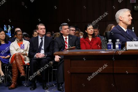 Supreme Court Justice nominee Neil Gorsuch listens on Capitol Hill in Washington, during his confirmation hearing before the Senate Judiciary Committee. Seated, from second from left are, former New Hampshire Senator Kelly Ayotte, Senator Cory Gardner, R-Colo. and Senator Michael Bennet, D-Colo